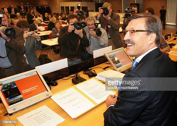 Photographers take pictures of HansJoachim Koerber chairman of the German retail and distribution giant Metro as he gives a press conference 21 March...