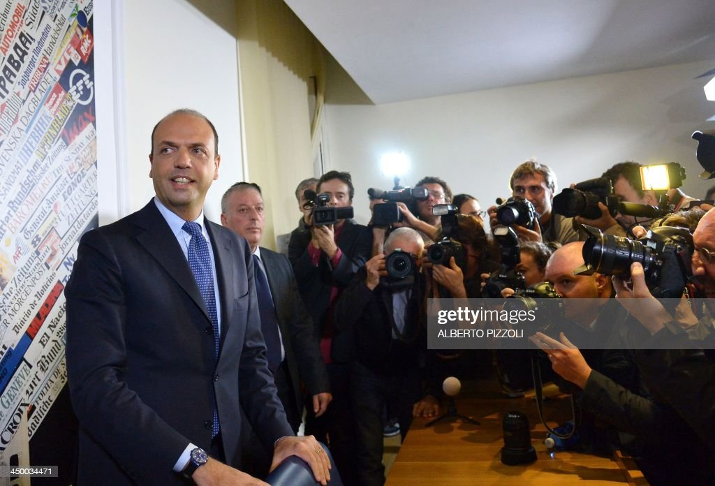 Photographers take pictures of Italy's deputy prime minister Angelino Alfano (L) during a press conference in Rome on November 16, 2013. Silvio Berlusconi's centre-right party has split, in the latest blow for the scandal-tainted billionaire ex-premier, who may be voted out of parliament at the end of the month. Alfano, Berlusconi's former right-hand man, announced he would not remain at the side of his onetime mentor and would form his own party instead.