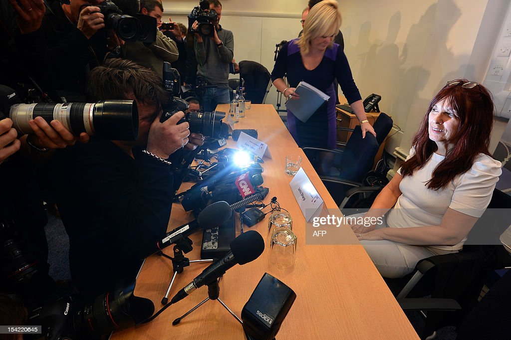 Photographers take pictures of Janis Sharp, mother of hacker Gary McKinnon, an Asperger's sufferer who broke into US military computers and who has fought a decade-long fight against extradition, following a press conference in London on October 16, 2012. Theresa May, British Home Secretary, said extradition would breach 46-year-old McKinnon's human rights as his psychiatrists believed there was a high risk that he would attempt suicide were he sent to the United States.