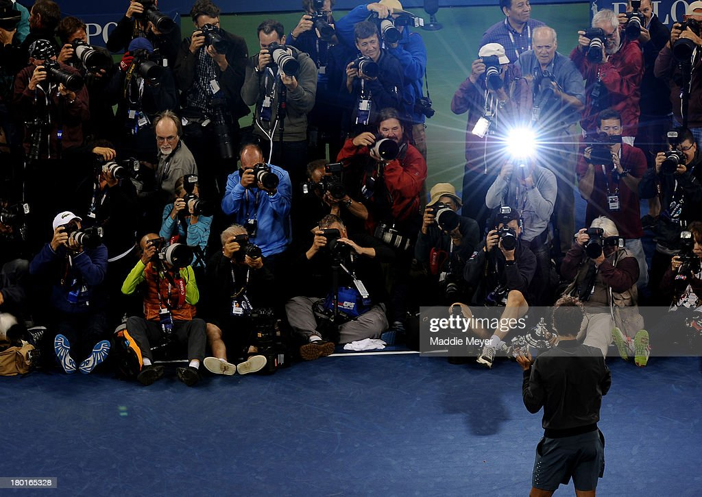 Photographers take pictures of <a gi-track='captionPersonalityLinkClicked' href=/galleries/search?phrase=Rafael+Nadal&family=editorial&specificpeople=194996 ng-click='$event.stopPropagation()'>Rafael Nadal</a> of Spain as he poses with the US Open Championship trophy after winning the men's singles final match against Novak Djokovic of Serbia on Day Fifteen of the 2013 US Open at the USTA Billie Jean King National Tennis Center on September 9, 2013 in the Flushing neighborhood of the Queens borough of New York City.