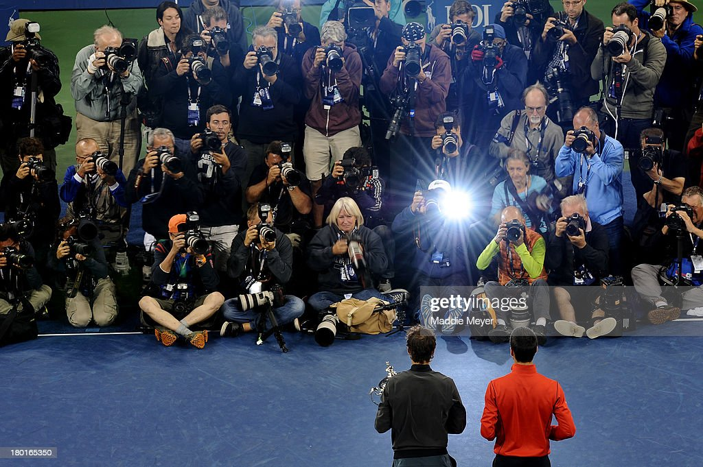 Photographers take pictures of Rafael Nadal of Spain as he poses with the US Open Championship trophy next to Novak Djokovic of Serbia after winning the men's singles final match on Day Fifteen of the 2013 US Open at the USTA Billie Jean King National Tennis Center on September 9, 2013 in the Flushing neighborhood of the Queens borough of New York City.