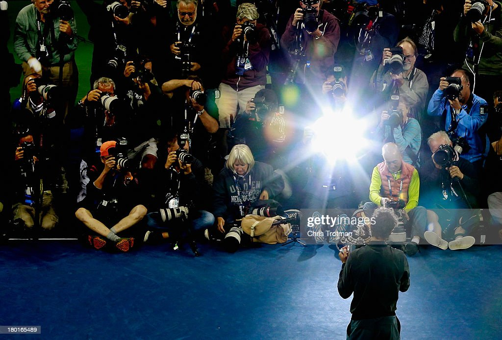 Photographers take pictures of Rafael Nadal of Spain as he poses with the US Open Championship trophy after winning the men's singles final match against Novak Djokovic of Serbia on Day Fifteen of the 2013 US Open at the USTA Billie Jean King National Tennis Center on September 9, 2013 in the Flushing neighborhood of the Queens borough of New York City.