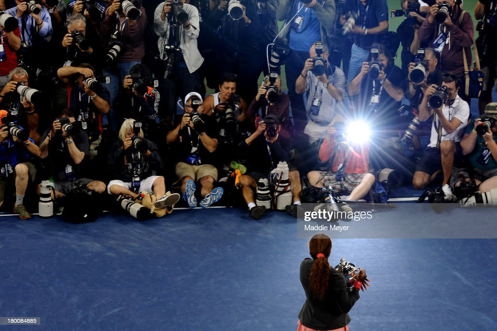 Photographers take pictures of <a gi-track='captionPersonalityLinkClicked' href=/galleries/search?phrase=Serena+Williams+-+Tennis+Player&family=editorial&specificpeople=171101 ng-click='$event.stopPropagation()'>Serena Williams</a> of the United States of America smiles as she poses with the trophy after winning her women's singles final match against Victoria Azarenka of Belarus on Day Fourteen of the 2013 US Open at the USTA Billie Jean King National Tennis Center on September 8, 2013 in the Flushing neighborhood of the Queens borough of New York City.