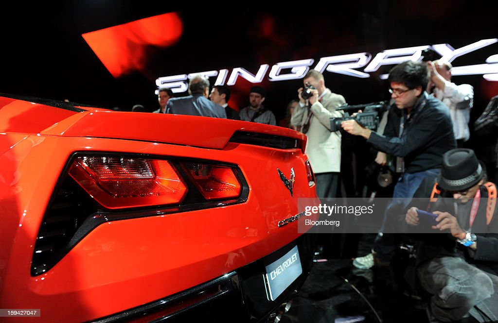 Photographers take pictures of the 2014 Chevrolet Corvette Stingray after the unveiling ahead of the 2013 North American International Auto Show (NAIAS) in Detroit, Michigan, U.S., on Sunday, Jan. 13, 2013. The new model, set to reach dealers in this year's third quarter, is part of the push to breathe new life into the Chevy brand, which accounted for 71 percent of GM's 2012 U.S. sales. Photographer: Daniel Acker/Bloomberg via Getty Images