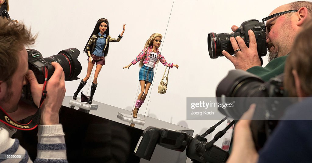 Photographers take pictures of the Barbie Collection 2014 at the Press-Preview of the Nuremberg International Toy Fair 2014 on January 28, 2014 in Nuremberg, Germany. The Barbie Collection 2014 was presented by Designer Guido Maria Kretschmer. The Nuremberg International Toy Fair 2014 is the worlds biggest toy fair and is opendend to visitors from January 29th to February 3rd.