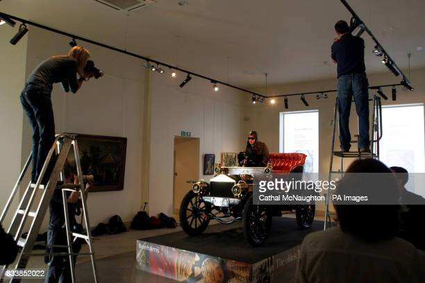 Photographers take pictures of the worlds oldest surviving Rolls Royce car no 20154 built in 1904 on display at Bonhams in London The vehicle is a...