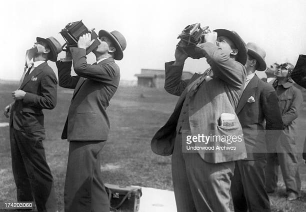 Photographers train their cameras upward at an aviation event Berlin Germany 1932