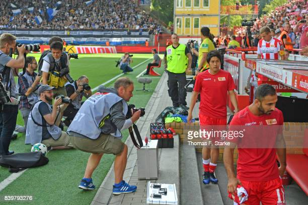 Photographers wait for Atsuto Uchida prior to the Second Bundesliga match between 1 FC Union Berlin and DSC Arminia Bielefeld at Stadion An der Alten...