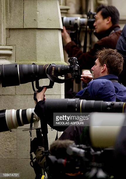 Photographers wait to get a picture of US actor Michael Douglas and his wife British actress Catherine Zeta Jones who are inside the High Court in...