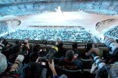 Photographers working during the Closing Ceremony in BC Stadium on February 28 during the Vancouver 2010 Olympic Winter Games AFP PHOTO / STEPHANIE...