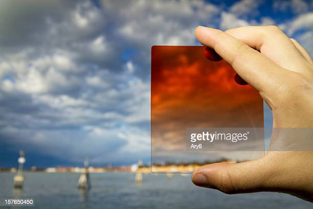 Photographic  equipment  in the hand (filter) on Venice background