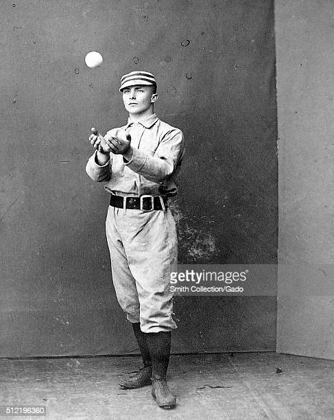 A photographic portrait of Tommy McCarthy wearing a Philadelphia Quakers uniform in the photograph he is catching a ball that was thrown to him he...