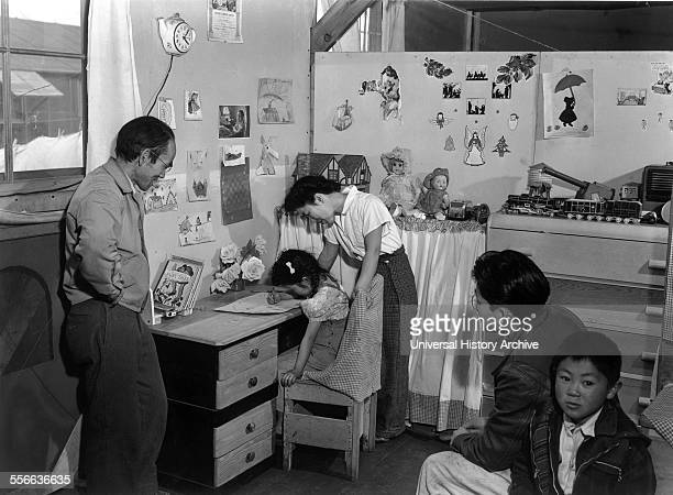 Photographic print of Tojo Miatake and family at the Manzanar Relocation Centre California Photographed by Ansel Adams Dated 1943