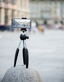 photographic stand with smartphone and display