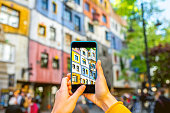 Photographing with smart phone colorful building facade in Vienna
