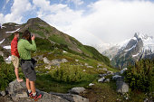 Photographing rainbow in mountains, White Rock Lakes, Ptarmigan Traverse, North Cascades, Washington, USA