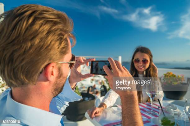 photographing woman outdoors on luxury restaurant terrace