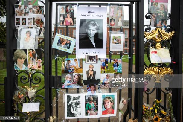 Photographs and messages sit outside an entrance gate to Kensington Palace ahead of the 20th anniversary of the death of Diana Princess of Wales on...