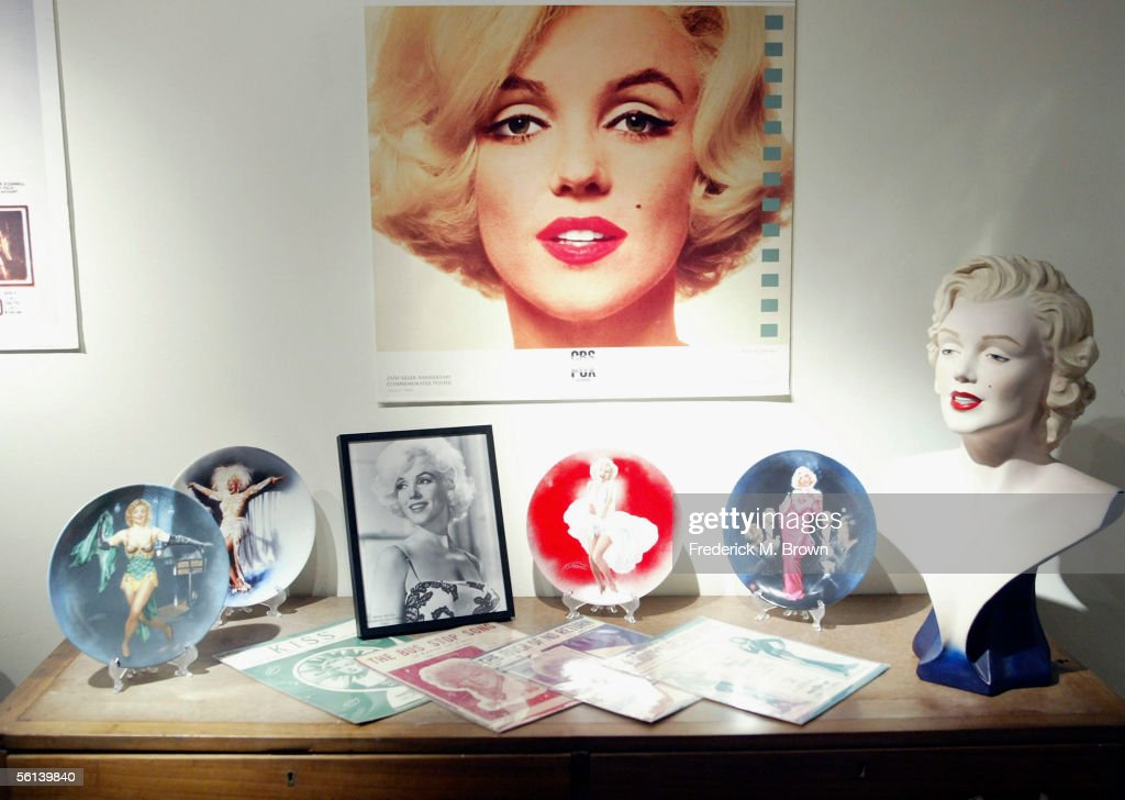 Photographs and other items owned by the late actress Marilyn Monroe is displayed during the unveiling of the Marilyn Monroe Exhibit at the Queen Mary on November 10, 2005 in Long Beach, California. The exhibit will reach 35 locations on 6 continents. (Photo by Frederick M. Brown/Getty Images).