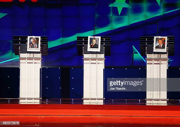 Photographs of Democratic Presidential candidates US Sen Bernie Sanders Hillary Clinton and former Maryland Gov Martin O'Malley hang on their debate...