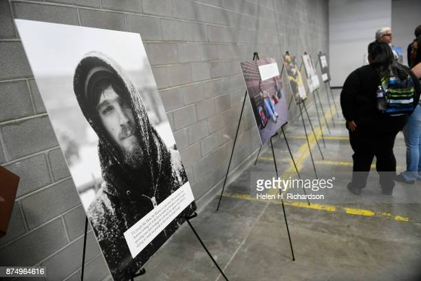 DENVER CO NOVEMBER 15 Photographs of homeless people are on display during a press conference to officially open a new homeless shelter for men...