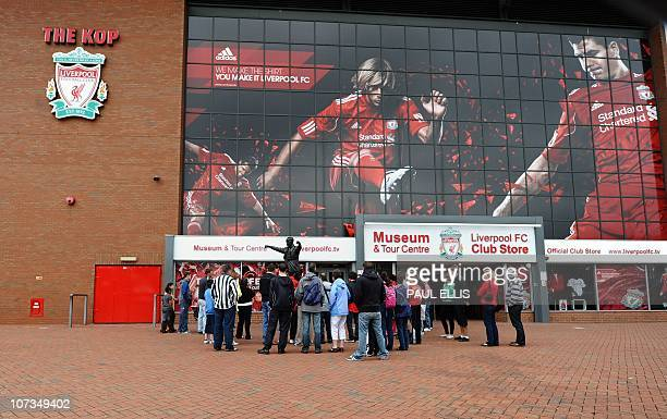 Photographs of Liverpool footballers Jamie Carragher Fernando Torres and Steven Gerrard are displayed as people stand at the entrance of Liverpool...