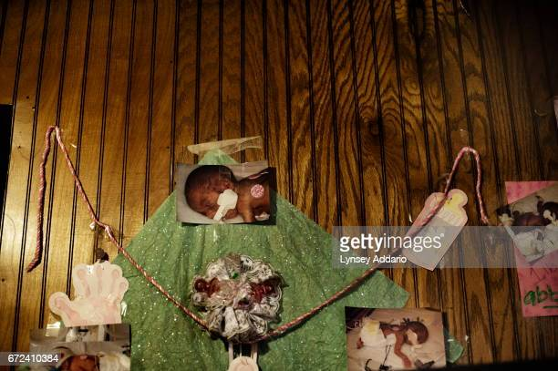 Photographs of Maranda's twins from birth hang on the wall in Maranda's bedroom in Ellisville Mississippi June 2 201 Maranda Corely sits in her...