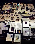 Photographs of missing people from the 11 September 2001 World Trade Center attack sit on a television truck outside Bellevue Hospital in New York 12...
