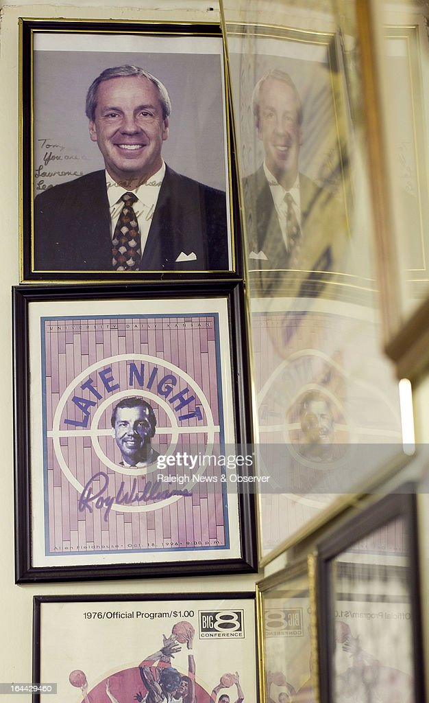 Photographs of Roy Williams hang in the back of Amyx's Barber Shop in Lawrence, Kansas, Saturday, March 23, 2013. Barber Mike Amyx cut Roy Williams' hair during the 15 years he lived in Lawrence and coached at the University of Kansas.