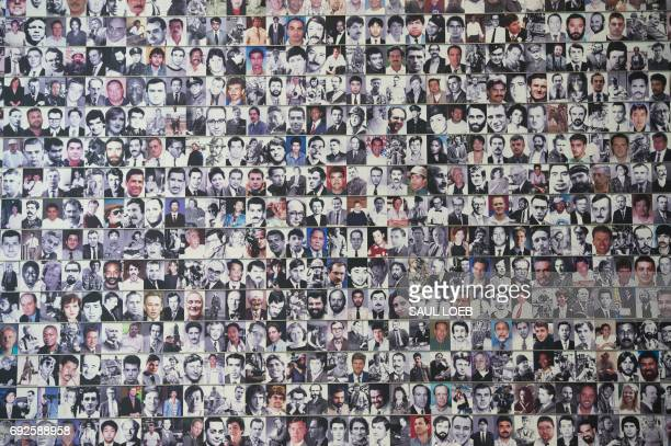Photographs of some of the more than 2300 journalists that have been killed or died while reporting the news are seen during the rededication of the...