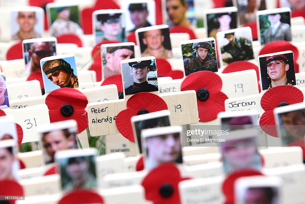 Photographs of the fallen are displayed on crosses adorned with poppies in the field of remembrance at Westminster Abbey on November 7, 2013 in London, England.