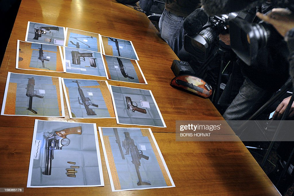 Photographs of weapons seized on the eve by French Police, are displayed to journalists on December 14, 2012, in Marseille, southern France, during a press conference held by Marseille's Prosecutor of the Republic about criminal cases occurred in Marseille in recent days, on December 14, 2012.