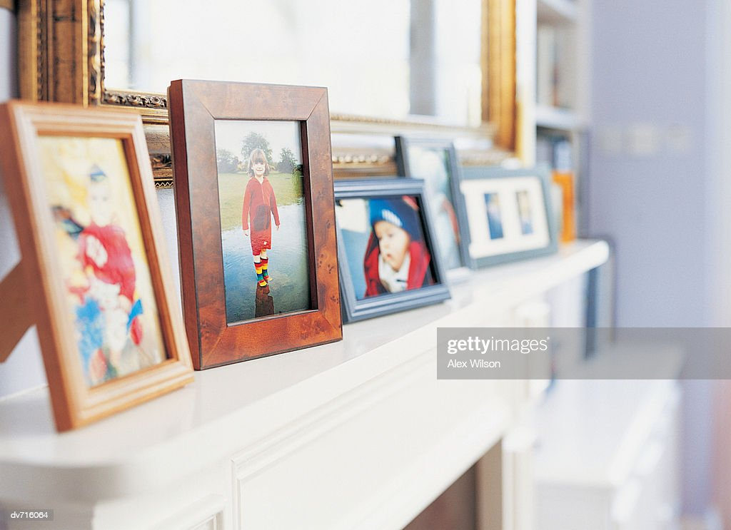 Photographs on a Mantelpiece : Stock Photo