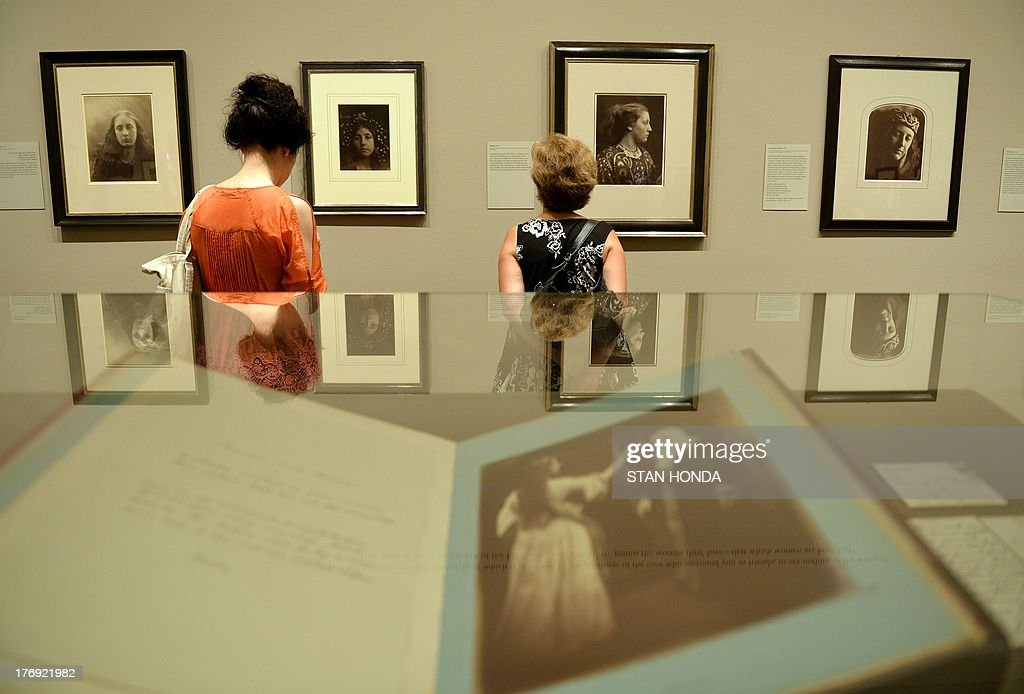 Photographs on display in the exhibition 'Julia Margaret Cameron' featuring work by the great British photographer Julia Margaret Cameron (1815-1879) August 19, 2013 at The Metropolitan Museum of Art in New York. In the glass case is 'Vivien and Merlin, 1874' in the book 'Illustrations to Tennyson's Idyls of the King, and Other Poems'. The exhibition is open from August 19, 2013 to January 5, 2014. AFP PHOTO/Stan HONDA