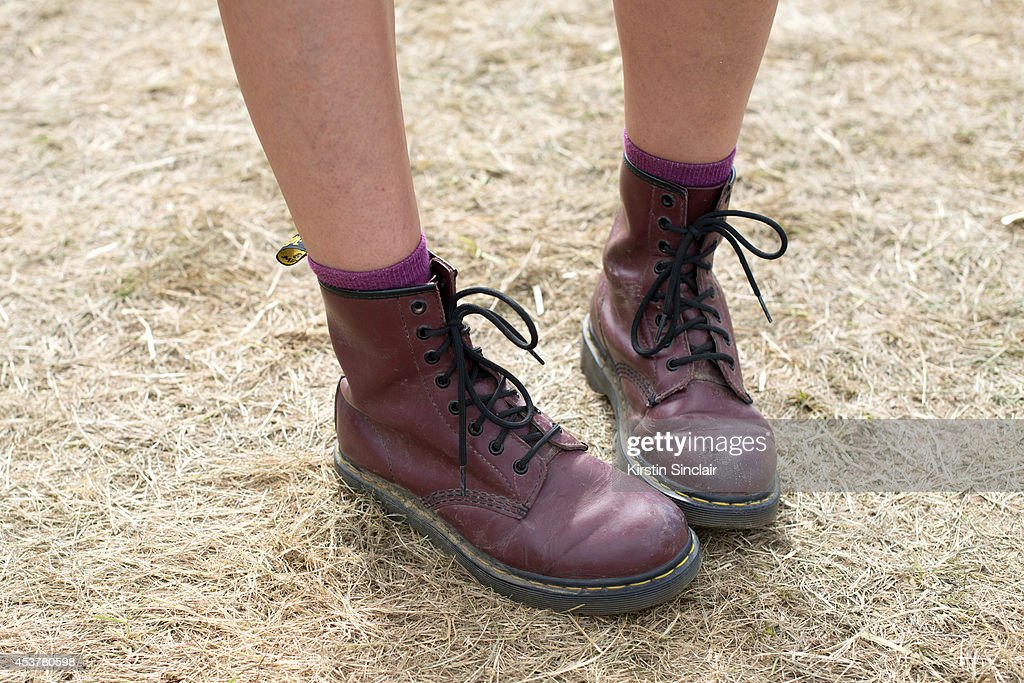 PARK ENGLAND Photography Assistant Caylee Hawkins wearing Doc Martens boots at Wilderness Festival on August 09 2014 in Cornbury Park Oxfordshire...