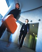 Photography of businessman and businesswoman Walking down the hallway, Portrait, Low Angle View, Blurred Motion
