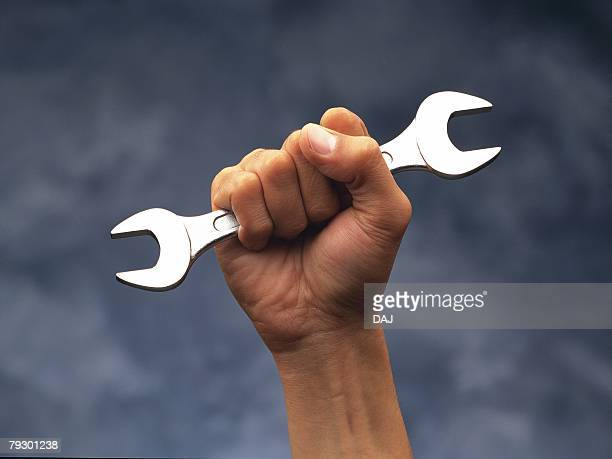 Photography of hand holding a wrench, Front View