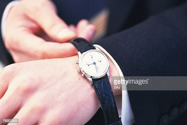 Photography of hands wearing a watch, Close Up, High Angle View