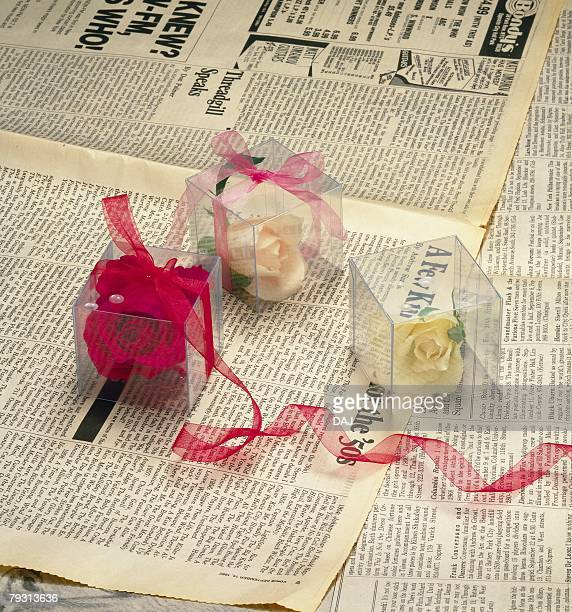 Photography of presents on news papers, High Angle View