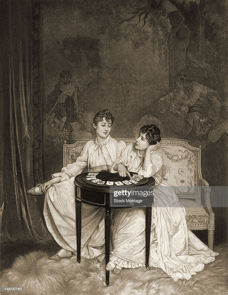 Photogravure is entitled 'Telling Fortunes' depicts a pair of women as they sit at a small table covered with cards 19th century