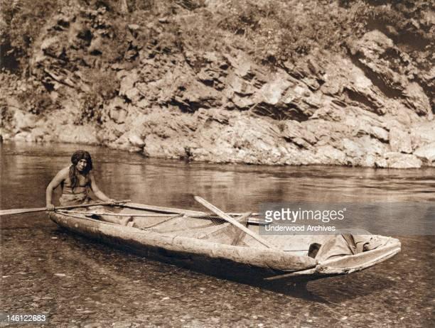 A photogravure of a Yurok in his canoe on the Trinity River California 1923