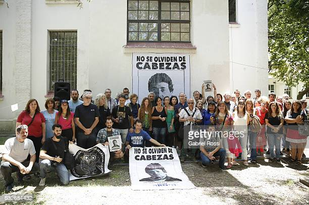 Photojournalist pose with banners to honour photographer Jose Luis Cabezas on the 20th anniversary of his assassination at Archivo Nacional de la...