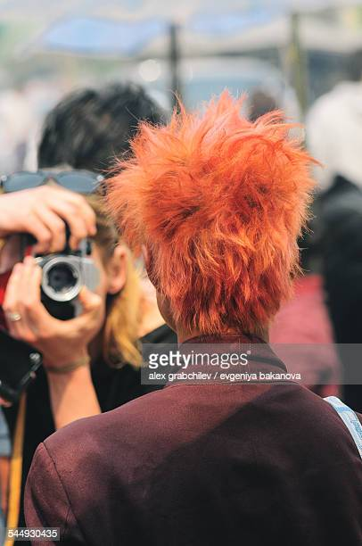 Photojournalist takes a picture of the red-haired