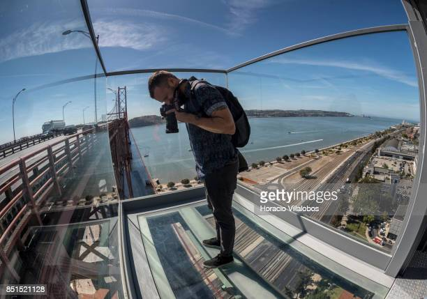 A photojournalist takes pictures from the viewpoint at 80 meters over street level of Pier 7 of 25 de Abril bridge site of the 'Experiencia Pilar 7'...