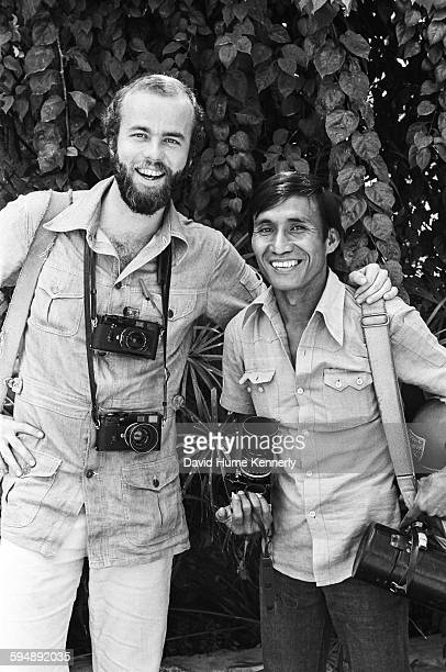 UPI photojournalists David Hume Kennerly and Willie Vicoy pose together circa 1975 in Saigon South Vietnam Vicoy would later be fatally injured...