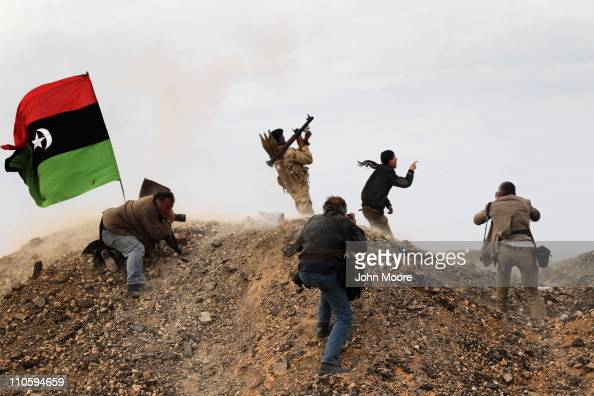 Photojournalists including New York Times staff photographer Tyler Hicks photograph Libyan rebels on March 10 2011 in Ras Lanuf Libya Hicks and three...