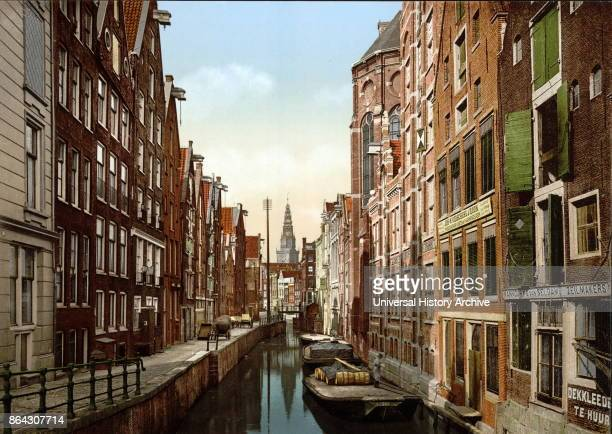 Photomechanical print depicting the Oudezijds Kolk canal in the center of Amsterdam in the district of De Wallen built in the fifteenth century it...
