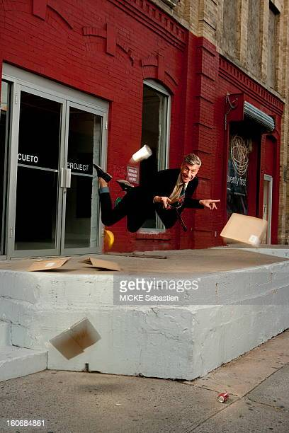 Photomontage smiling attitude of the Italian artist Maurizio CATTELAN 'suspended in the air' posing in a street in NEW YORK in the Chelsea...