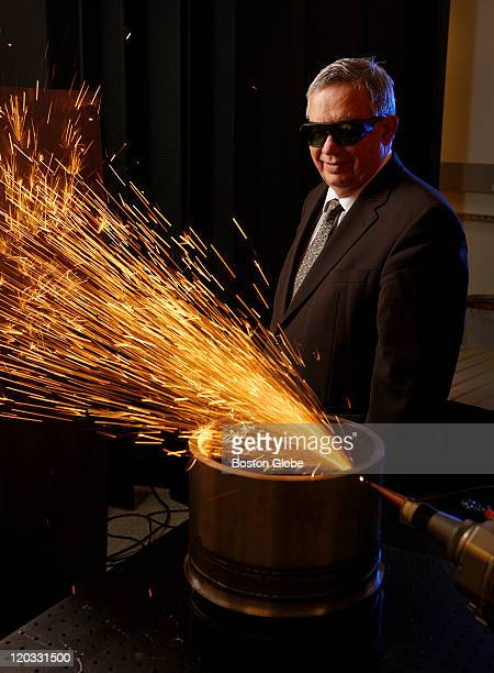 Photonics CEO Valentin Gapontsev photographed at the company's headquarters in front of a 20000 watt fiber laser cutting through 1/2 inch lowcarbon...