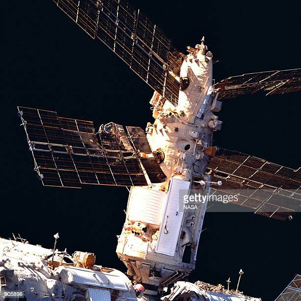 Russia's Mir Space Station's Spektr Module shows the backside of a solar array panel and damage incurred by the impact of a Russian unmanned Progress...